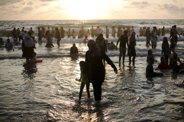 Muslims, most from the West Bank and East Jerusalem, enjoy the water of the Mediterranean in Tel Aviv during Eid al-Fitr, which marks the end of the holy month of Ramadan July 19, 2015. (Photo by Baz Ratner/Reuters)
