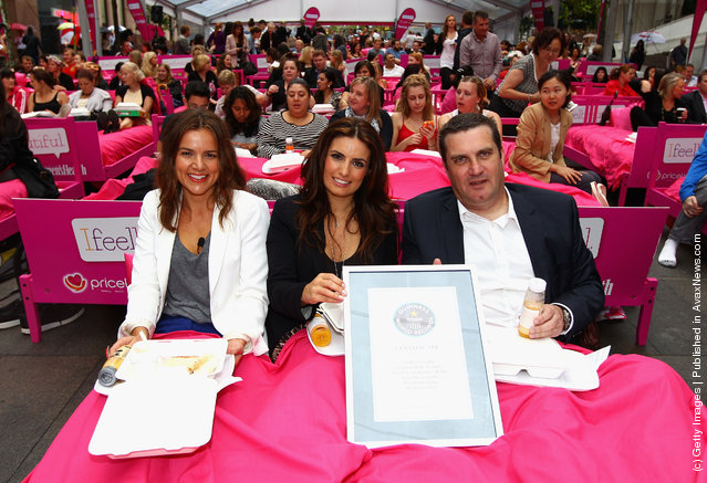 Felicity Harley, Ada Nicodemou and Stephen Roche attend The World's Biggest Breakfast in Bed Guinness World Record Attempt at Martin Place in Sydney, Australia
