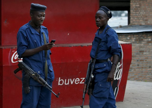 Burundi police patrol the streets of Musaga district in the capital Bujumbura after the results of this weeks presidential elections were released, July 24, 2015.  President Pierre Nkurunziza  won a third-term in office after the opposition boycotted the vote, a victory that leaves the east African nation politically divided and facing international isolation after months of unrest. (Photo by Mike Hutchings/Reuters)