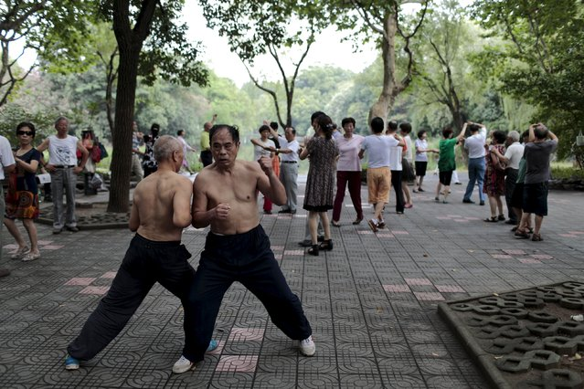 Men exercise in a park in Shanghai, China, July 23, 2015. (Photo by Aly Song/Reuters)
