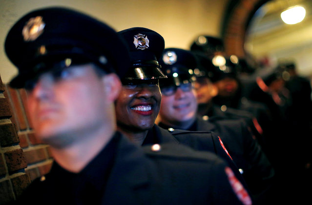 Chicago Fire department candidate firefighter Gwen Stevenson smiles as she waits for the start of her graduation ceremony in Chicago, Illinois, U.S. May 31, 2016. (Photo by Jim Young/Reuters)