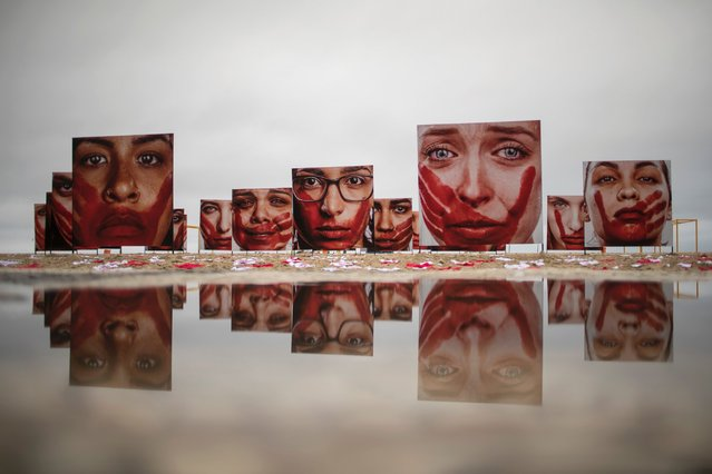 "Marcio Freitas' photos themed ""I'll Never Be Silent"" of models portraying the anguish suffered by abuse are displayed on Copacabana beach, in a protest against rape and violence against women, June 6, 2016, in Rio de Janeiro. According to the NGO, some 50,000 women each year are sexually assaulted in Brazil. (Photo by Felipe Dana/AP Photo)"