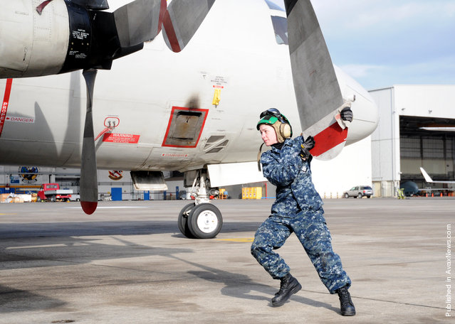 Aviation Machinist's Mate Airman Sarah Rutledge, assigned to the Golden Swordsmen of Patrol Squadron (VP) 47, inspects propeller number four for damage as part of a daily inspection