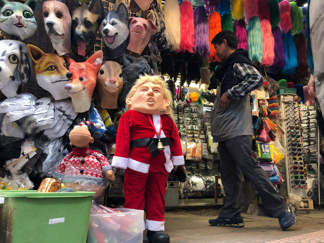 A U.S. President Donald Trump mask is seen for sale in a market in Hong Kong, China, December 23, 2019. (Photo by Lucy Nicholson/Reuters)
