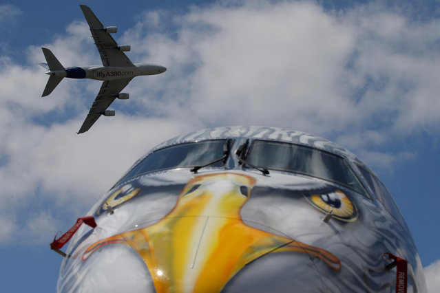 An Airbus A380 flies over an Embraer E190-E2 during a flying display at the 52nd Paris Air Show in Le Bourget Airport near Paris on June 23, 2017. (Photo by Pascal Rossignol/Reuters)
