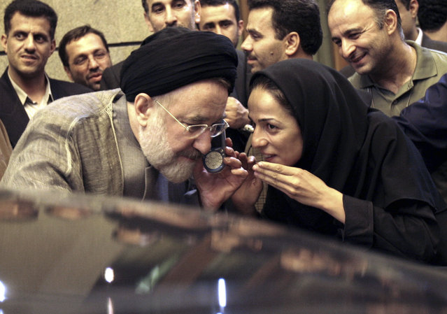 In this July 13, 2005, file photo, outgoing reformist Iranian President Mohammad Khatami talks on the phone with the mother of female journalist Masih Alinejad, right, after meeting with journalists in Tehran, Iran. Alinejad, famous for her campaign against the Islamic Republic's mandatory headscarf, or hijab, for women filed a lawsuit on Monday, Dec. 2, 2019, in U.S. federal court against Iran, alleging a government-led harassment campaign targets her and her family. (Photo by Hasan Sarbakhshian/AP Photo/File)