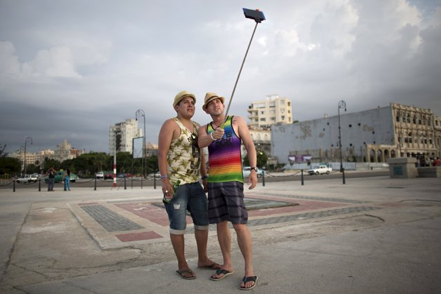 Tourist Sergio Morcoso, 28, (L) from Bolivia, poses for a photo with his friend Yusinel Morales, 30, from Cuba, in Havana, July 18, 2015. (Photo by Alexandre Meneghini/Reuters)
