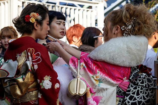 Young Japanese women dressed in colorful kimonos gather for a ceremony marking the Coming of Age Day at Toshimaen Amusement Park in Tokyo, Japan, 13 January 2020. (Photo by Christopher Jue/EPA/EFE)