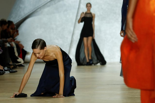 A model stumbles as she presents a creation by Swiss designer Albert Kriemler as part of his Spring/Summer 2020 women's ready-to-wear collection show for fashion house Akris during the Paris Fashion Week in Paris, France, September 29, 2019. (Photo by Gonzalo Fuentes/Reuters)