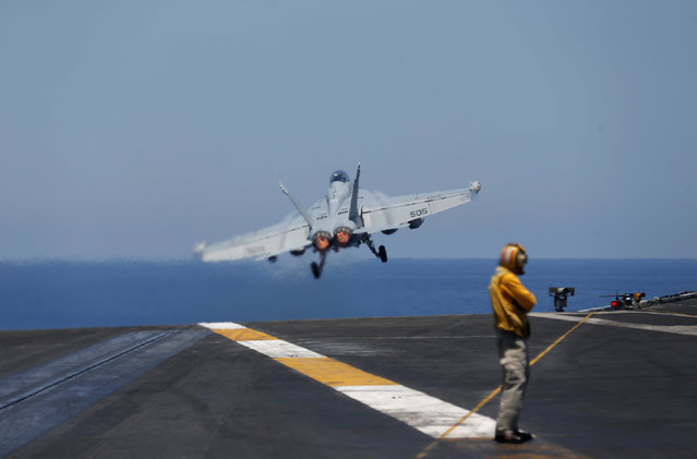 F/A-18 fighter jet takes off from the USS Harry S. Truman aircraft carrier in the eastern Mediterranean Sea June 13, 2016. (Photo by Baz Ratner/Reuters)