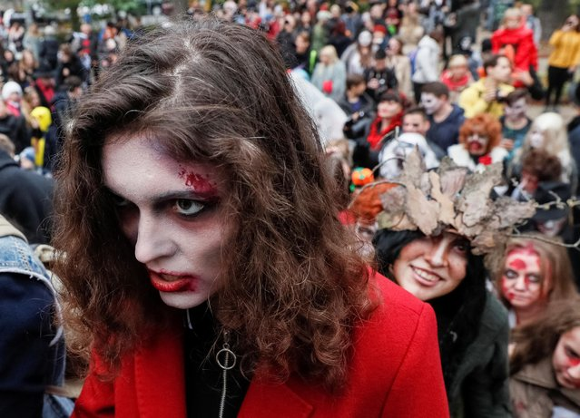"""Participants dressed as zombies take part in a """"Zombie Walk"""" parade to celebrate upcoming Halloween in Kiev, Ukraine on October 26, 2019. (Photo by Gleb Garanich/Reuters)"""