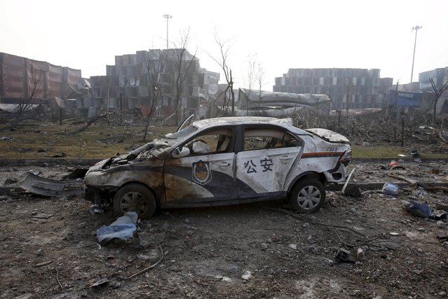 A damaged police car is pictured at the site of Wednesday night's explosions in Binhai new district of Tianjin, China, August 15, 2015. (Photo by Reuters/China Daily)