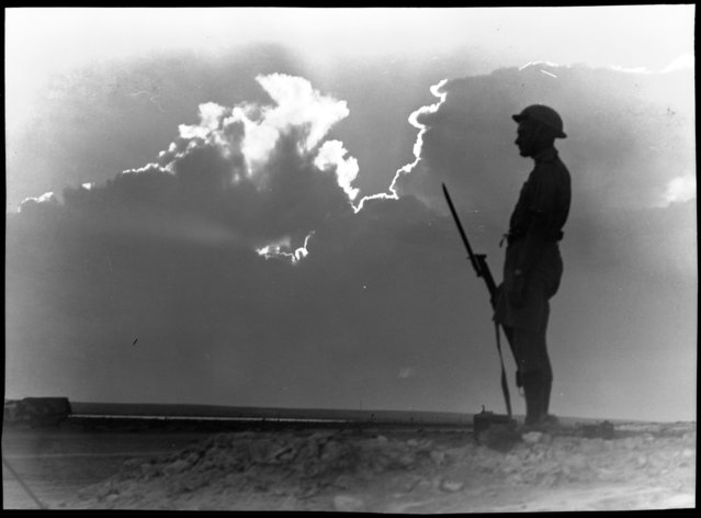 El Alamein (lone soldier on guard in silhouette). Between 1914 and 1945