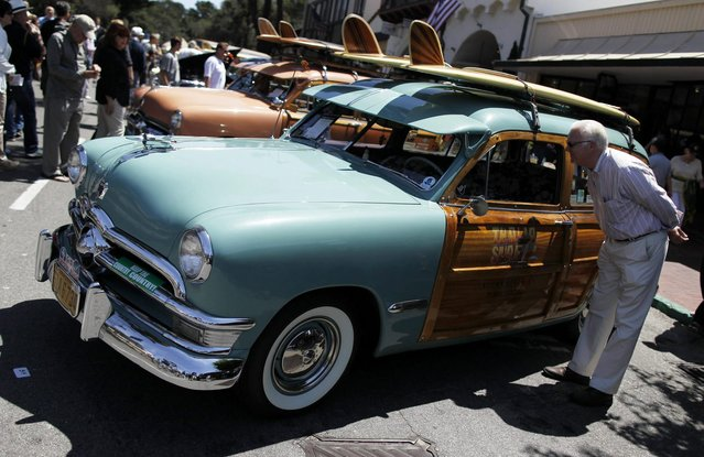 A 1950 Ford Country Squire Station Wagon is displayed during the Carmel-by-the-Sea Concours on the Avenue car show in Carmel, California, August 12, 2014. (Photo by Michael Fiala/Reuters)