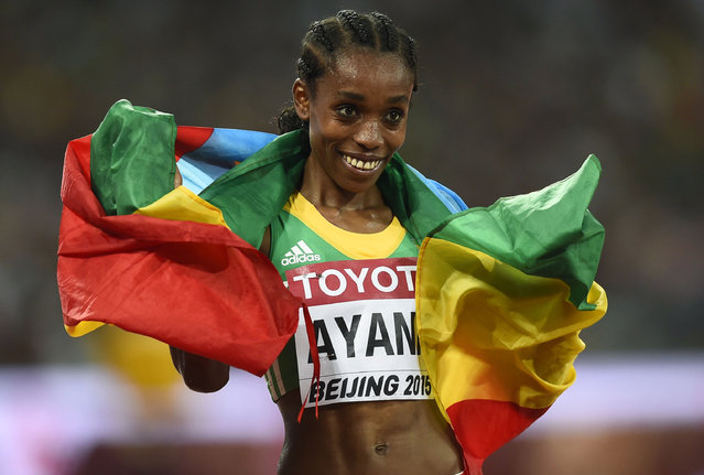 Almaz Ayana of Ethiopia poses with her national flag after winning the women's 5000 metres final at the 15th IAAF Championships at the National Stadium in Beijing, China August 30, 2015. (Photo by Dylan Martinez/Reuters)