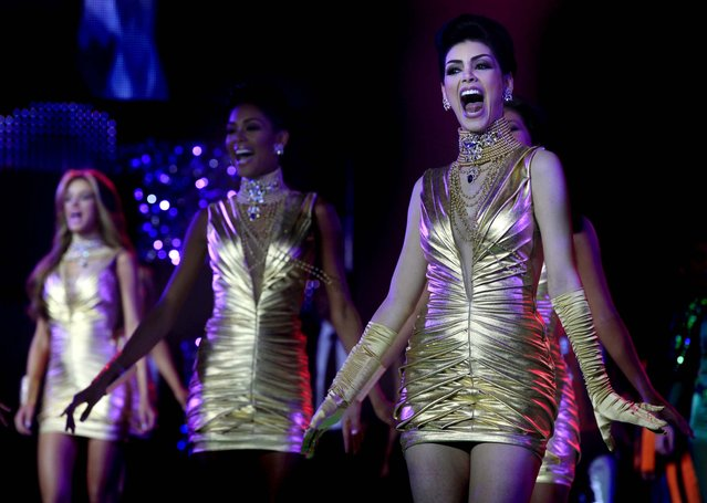 Contestants perform during the Miss Venezuela 2012 beauty contest in Caracas on August 30, 2012. (Photo by Ariana Cubillos/Associated Press)