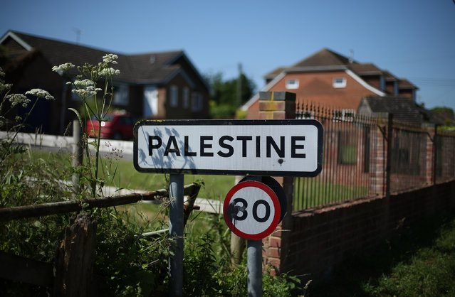 """A roadside sign in the village of Palestine on July 10, 2013 in the county of Hampshire, England. Local people believe the area was part of the """"Land fit for Heroes"""" scheme for helping former World War I soldiers. Others say that the area was settled by jewish refugees, who were given pre-fabricated housing in the area. (Photo by Peter Macdiarmid/Getty Images)"""