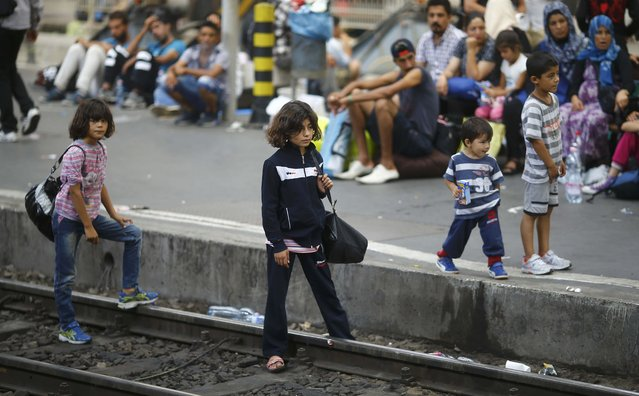 Migrants wait on a platform for a train at the Keleti train station in Budapest, Hungary, September 3, 2015. (Photo by Leonhard Foeger/Reuters)
