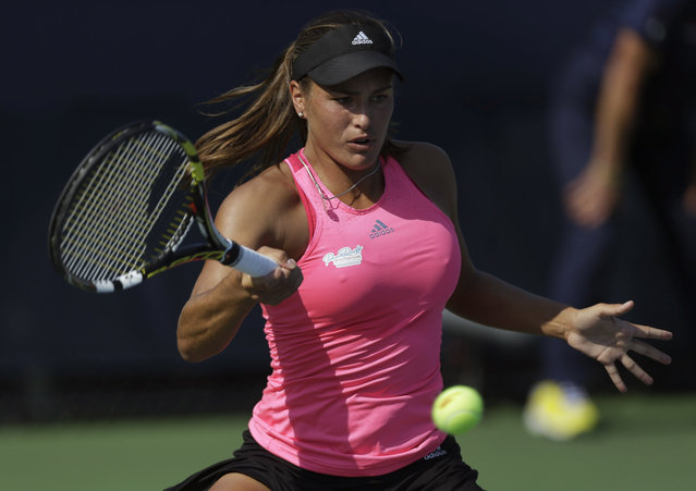 Monica Puig, of Puerto Rico, returns a shot against Andrea Petkovic, of Germany, during the second round of the 2014 U.S. Open tennis tournament, Wednesday, August 27, 2014, in New York. (Photo by Frank Franklin II/AP Photo)