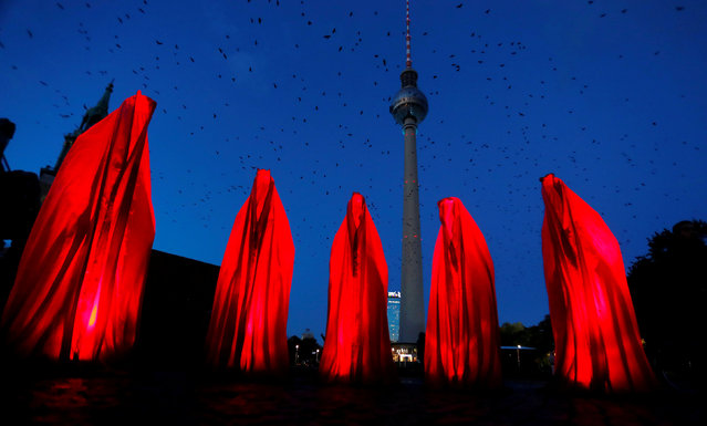 The TV tower is illuminated during the Festival of Lights show in Berlin, Germany, October 6, 2017. (Photo by Hannibal Hanschke/Reuters)