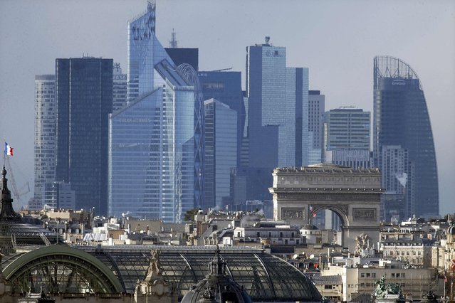 General view of the skyline of La Defense business district behind the Paris landmark and the Arc de Triomphe, in Paris, France, January 14, 2016. (Photo by Charles Platiau/Reuters)