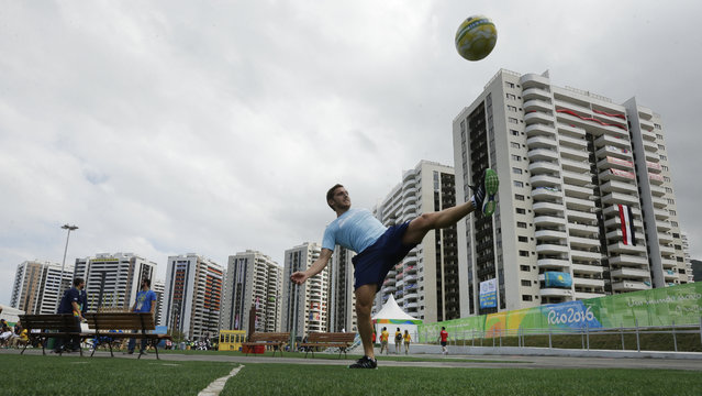 Argentine field hockey player Lucas Vila passes a soccer ball at the Olympic athletes village in Rio de Janeiro, Brazil, Sunday, July 31, 2016. (Photo by Charlie Riedel/AP Photo)