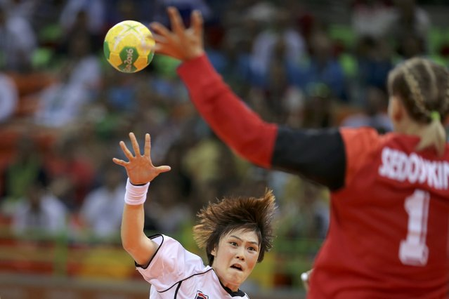2016 Rio Olympics, Handball, Preliminary, Women's Preliminary Group B Russia vs South Korea, Future Arena, Rio de Janeiro, Brazil on August 6, 2016. Yoo Hyun-Ji (KOR) of South Korea and Goalkeeper Anna Sedoykina (RUS) of Russia in action. (Photo by Marko Djurica/Reuters)