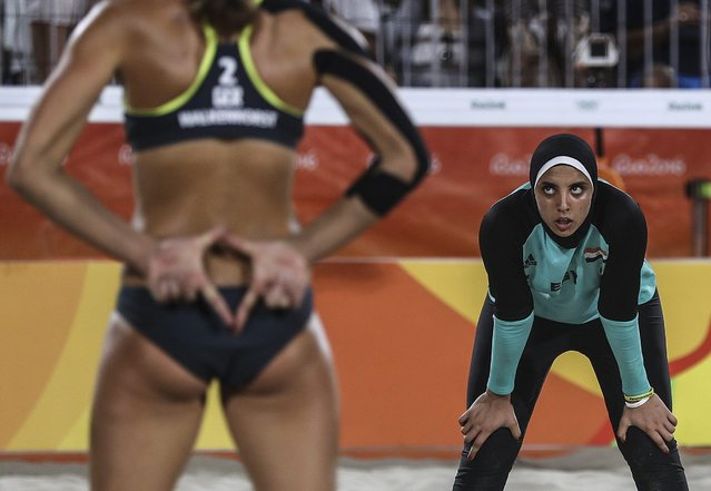 Kira Walkenhorst of Germany (L) signals as Doaa Elghobashy of Egypt (R) watches during the women's Beach Volleyball preliminary pool D game between Ludwig/Walkenhors of Germany and Elghobashy/Nada of Egypt the Rio 2016 Olympic Games at the Beach Volleyball Arena on Copacabana Beach in Rio de Janeiro, Brazil, 07 August 2016. (Photo by Antonio Lacerda/ANSA)
