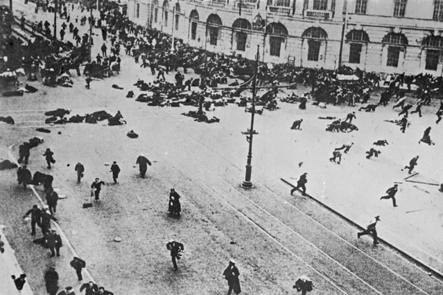 In this photo taken in July 4, 1917, provided by Karl Bulla Historical Foundation, Russian troops fire on demonstrators with machine guns, on the corner of Nevsky Prospect and Sadovaya Street, in St.Petersburg, Russia. The 1917 Bolshevik Revolution was long before the digital revolution allowed anyone to instantly document events. But the clumsy cameras of the time still caught some images that capture the period's drama. (Photo by Karl Bulla/Karl Bulla Historical Foundation via AP Photo)