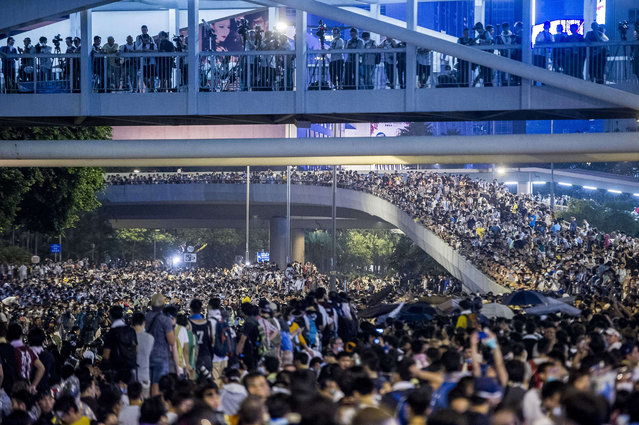 Pro-democracy protesters demonstrate in Hong Kong on September 28, 2014. Police fired tear gas as tens of thousands of pro-democracy demonstrators brought parts of central Hong Kong to a standstill on September 28, in a dramatic escalation of protests that have gripped the semi-autonomous Chinese city for days. (Photo by Xaume Olleros/AFP Photo)