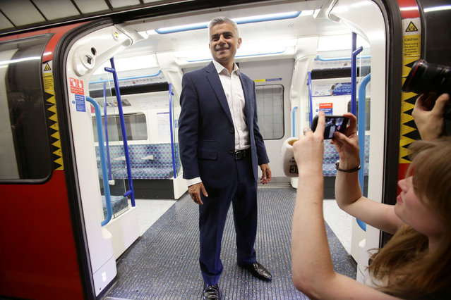 Mayor of London Sadiq Khan poses for the media on a Victoria line tube train carriage at Brixton Underground station, during the launch of London's Night Tube August 20, 2016. (Photo by Yui Mok/Reuters/PA Wire)