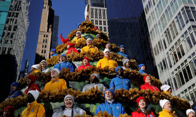 People singing carols during the 91st Macy's Thanksgiving Day Parade in the Manhattan borough of New York City, New York, U.S., November 23, 2017. (Photo by Andrew Kelly/Reuters)