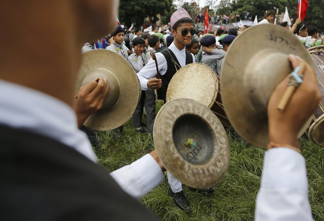 People dressed in traditional attire play musical instruments as they take part in a celebration a day after the first democratic constitution was announced in Kathmandu, Nepal September 21, 2015. (Photo by Navesh Chitrakar/Reuters)