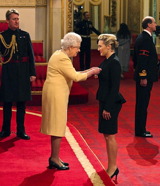 "Actress Kate Winslet is awarded a CBE, for services to drama by Queen Elizabeth II, during an Investiture ceremony at Buckingham Palace in London, November 21, 2012. She recieved the honor for her ""significant contribution"" to modern Britain. (Photo by Dominic Lipinski/PA)"