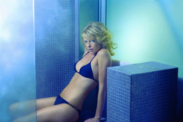 In this photo released by Esquire Magazine, actress Charlize Theron poses for a photo in Esquire Magazine, who identified Theron as the sexiest woman alive, for their November 2007, issue being released on October 16. (Photo by Sheryl Nields/AP Photo/Esquire Magazine)
