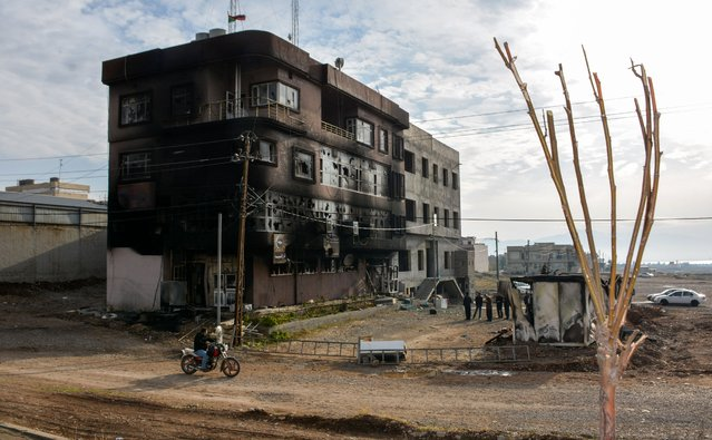 A picture taken on December 20, 2017 shows the burnt premises of the Kurdistan Islamic Union party, in the city of Raniya, 130 kilometres north of Sulaymaniyah in the autonomous Iraqi Kurdistan region, as protests against political corruption raged for a third day despite a clampdown by security forces after five people were killed. Protesters have unleashed their fury at all five of the autonomous Kurdish region's main political parties, not just the Kurdistan Democratic Party (KDP) of former regional president Massud Barzani who organised the fateful poll for independence in September 2017 which drew sweeping reprisals from Baghdad and dealt a heavy blow to the region's already flagging economy. (Photo by Shwan Mohammed/AFP Photo)