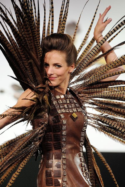 Models wears a creation made with chocolate during a fashion show at the inauguration of the 20th annual Salon du Chocolat in Paris, France on October 28, 2014. (Photo by Jerome Domine/ABACA Press)