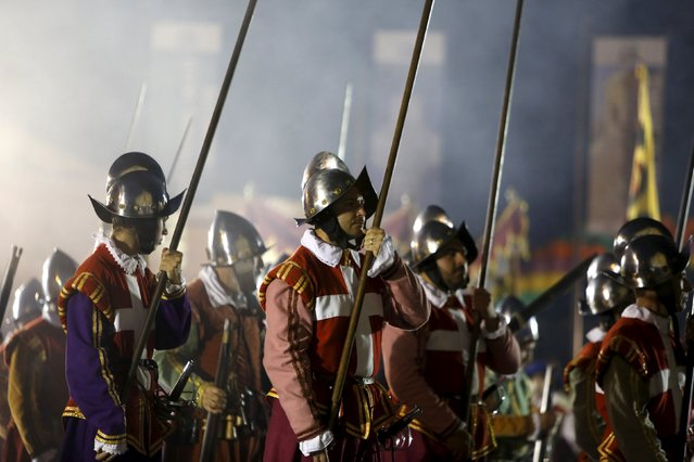 Re-enactors carry their pikes during a historical re-enactment of the inspection of Fort St. Elmo during Notte Bianca (White Night) celebrations in Valletta, Malta, October 3, 2015. The White Night, an all-night cultural event, is celebrated in various cities all over the world. (Photo by Darrin Zammit Lupi/Reuters)