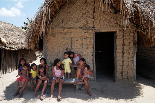 Women gather in a small village within the  Araribóia Indigenous Reserve, Maranhão, Brazil on August 8, 2015. (Photo by Bonnie Jo Mount/The Washington Post)