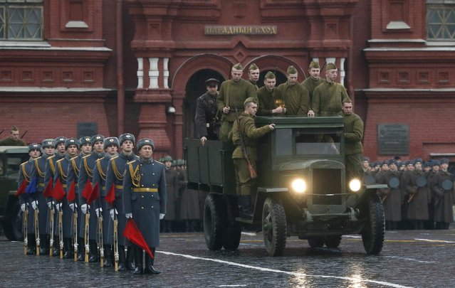 Men, dressed in historical uniforms, drive a truck during a military parade in Red Square in Moscow, November 7, 2014. (Photo by Maxim Shemetov/Reuters)