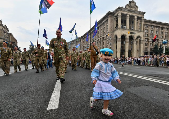 People, including veterans of the ongoing war against Russian-backed separatists in the east of the country, relatives of those killed in the armed conflict, fighters of volunteer battalions and activists, take part in a march on Ukraine's Independence Day in Kiev on August 24, 2020. (Photo by Genya Savilov/AFP Photo)