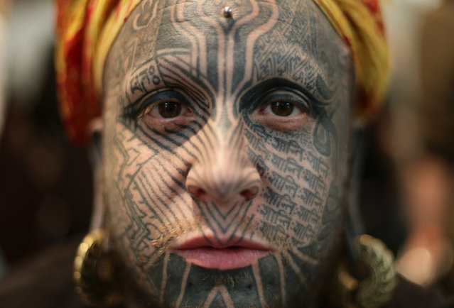 Body modification artist Shiva 108 shows his full-face tattoo at the International London Tattoo Convention in London, Britain September 23, 2016. (Photo by Yui Mok/PA Wire)