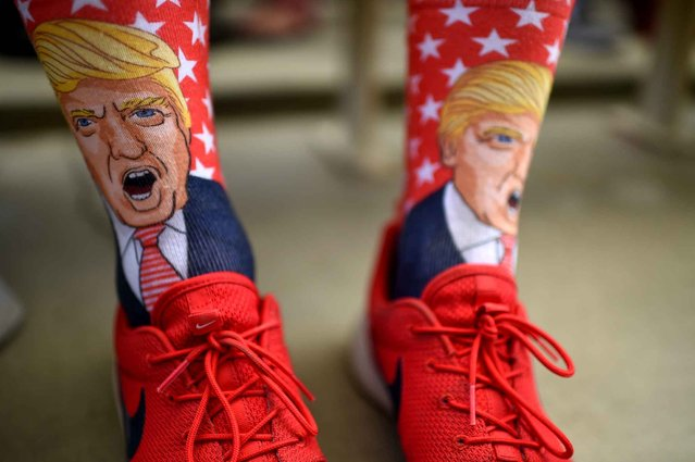 Terrence O'Hagan from Mission Viejo, California wears socks decorated with an image of Republican presidential candidate Donald Trump during a campagin rally for Trump on October, 5, 2016 at the Henderson Pavilion in Henderson, Nevada. (Photo by Robyn Beck/AFP Photo)