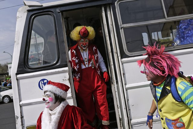 Clowns arrive for their annual pilgrimage to the Basilica of Our Lady Guadalupe to pay homage to the Virgin of Guadalupe in Mexico City December 16, 2014. (Photo by Carlos Jasso/Reuters)