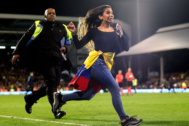 A Colombia fan clearly regrets invading the pitch as she is chased by a large security guard during the International Friendly match between Australia and Colombia at Craven Cottage on March 27, 2018 in London, England. (Photo by Charlotte Wilson/Offside/Getty Images)