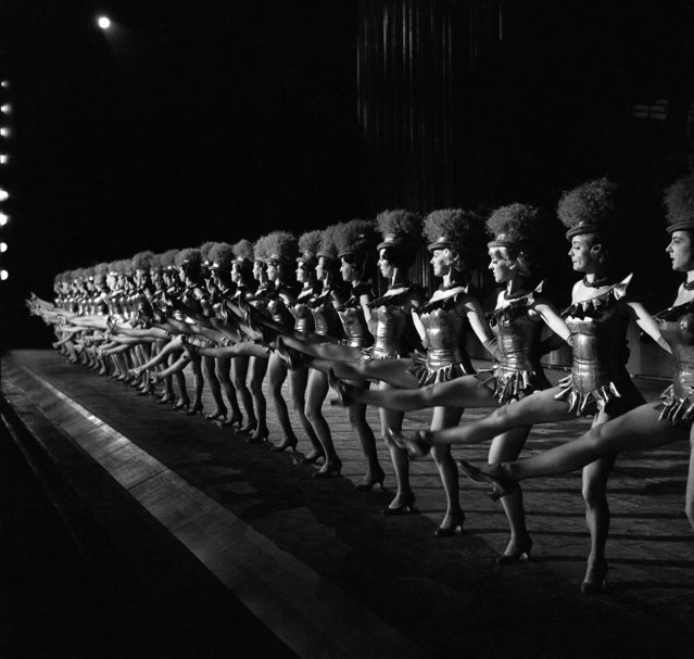 The 36 Rockettes go through a dance number as they rehearse for their Christmas show at Radio City Music Hall in New York in December 1963. (Photo by Dan Grossi/AP Photo)