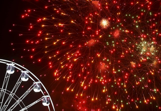 Fireworks explode over the Wheel of Light during Diwali celebrations in Leicester, Britain November 11, 2015. (Photo by Darren Staples/Reuters)