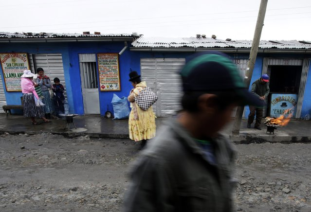 Aymara people are seen at the witches market of El Alto, on the outskirts of La Paz, December 31, 2014. (Photo by David Mercado/Reuters)