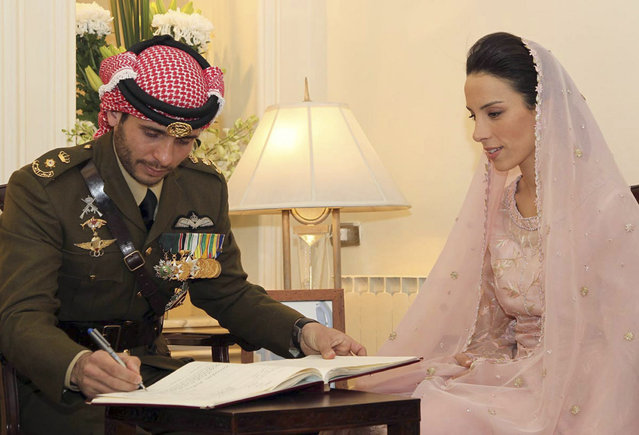 Jordan's Prince Hamzeh bin al-Hussein, brother of Jordan's King Abdullah, signs wedding papers next to his bride Princess Basma, during their marriage ceremony at the Royal Palace in Amman, January 13, 2012. (Photo by Yousef Allan/Reuters/Royal palace)