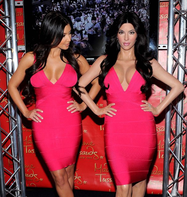 Kim Kardashian, (left) unveils her wax figure replica at Madame Tussauds New York. (Photo by Evan Agostini/Associated Press)